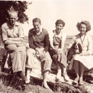 My mother holding her English Cocker, Peter, with her brother and parents at Parksville, BC.